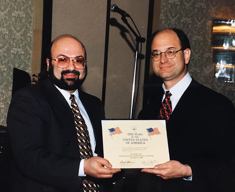 Dr. Davytan getting awards